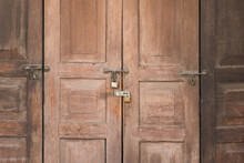 Aged Wooden Door Pattern Which Is Locked By Keypad And Rusty Hasp. Vintage Style Building And Background Photo.