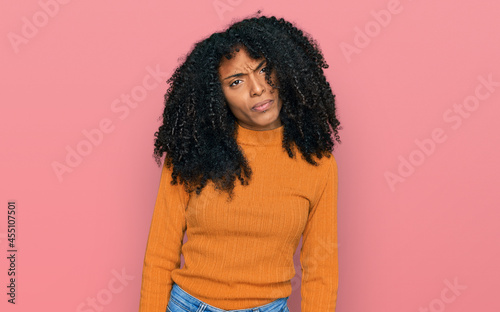 Carta da parati Young african american girl wearing casual clothes skeptic and nervous, frowning upset because of problem