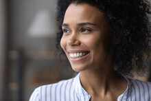 Positive Thinking. Close Up Of Attractive Young Black Lady With Beautiful Smile On Face Look At Distance Feel Glad Happy Motivated. Pleasant Millennial Biracial Woman Enjoy Good Mood Dreams Of Future