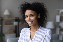 Pretty Lady. Portrait Of Attractive Smiling Young Afro American Female At Home. Head Shot Of Beautiful Millennial Mixed Race Woman In Casual Look At Camera Demonstrate Pearly White Even Teeth In Smile