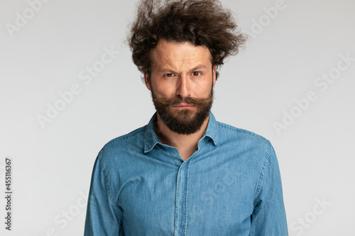 Stampa su Tela serious bearded fashion model in denim shirt frowning and posing