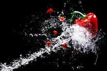 Red Pepper Splash In Water