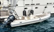 Motor Boat Near The Yacht.