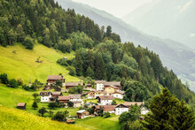 Beautiful Shot Of A Small Village On A Hilltop Surrounded By Vegetation