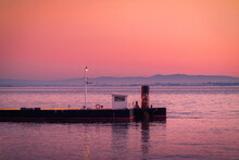 Ferry Terminal On Rippling River At Sunset