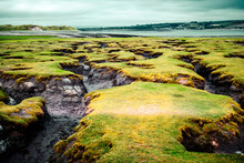 Dramatic Landscape Of Land Formations At Westward Ho! Nature Reserve At Low Tide