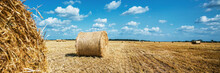 Wheat Straw Bales On Agricultural Field At Autumn Season.