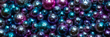 Beautiful Background With Nacreous Dark Pearls, Top View. Abstract Texture For Festive Backgrounds. Shiny Multicolored Dark Surface Of Christmas Decorations. Gems Close-up. Black Bright Background.