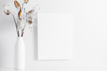 White Canvas Mockup With Shadow And Vase With Dry Flower Decoration.