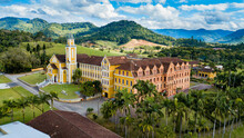 Mosteiro De Corupá, SC - Beautiful Architecture Of The Monastery With The Surrounding Nature And Mountains In The Background