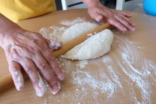 """Process Of Making A Traditional Turkish Dough Is Called """"Borek"""", Selective Focus. It Is Called """"Kol Boregi"""" In Turkish. Round Pie With Cheese, Spinach, Greased With Yolk. Delicious Balkan Pie."""