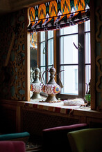 Antique Pitcher Near Window In Cafe