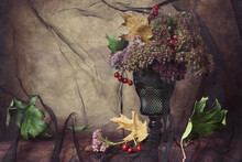 Autumn Bouquet With Dry Oak Leaves, Pink Flowers With Red Berries On Rustic Background Covered With Black Tulle