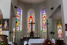 Altar Of Immaculate Conception Cathedral (Cathedral Of Our Lady Of Immaculate Conception, Cathedral Of Victoria) With Colorful Stained Glass Windows With Saints, Victoria, Seychelles.