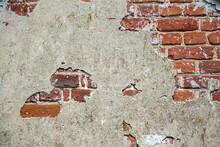 The Wall Is Made Of Red Brick With Remnants Of Plaster