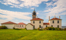 Lighthouse And Red Roof Keepers House On The Green Meadow At Beaver Trail State Park In Rhode Island