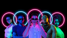 Collage Made Of Multiethnic Young People Standing Together Isolated On Dark Studio Background In Multicolored Neon Light With Geometric Luminescent Shape Cirlce