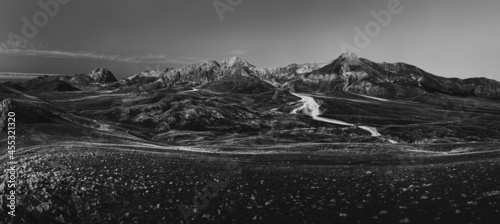 Fotografie, Obraz light and clouds on the peaks of the Gran Sasso massif and Campo Imperatore plat