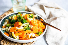 Bowl Of Beans, Carrots, Broccoli And Cauliflower With A Glass Of Ice Water