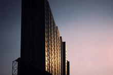 Condiminium Tall Sky Scraper In Dawn Or Sunset Time