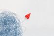 Leinwandbild Motiv Business for solution concept. red paper plane on white background