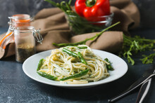 Plate Of Tasty Pasta With Green Beans On Dark Background