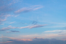 Blue Sky In The Evening With Feathery White And Dark Clouds At Dusk
