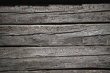 Old Wood Background With Engraved Letters