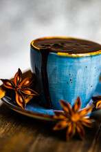 Close-up Of A Cup Of Fresh Hot Chocolate With Star Anise And Cinnamon