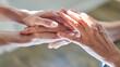 Leinwandbild Motiv Hände halten als Symbol für Beistand und Anteilnahme