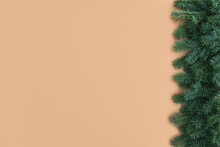 Retro Christmas Beige Backdrop. Festive Winter Composition With Border Of Fluffy Green Fir Tree Branches On Neutral Background. Trendy Minimal Xmas Ornament Template. Top View, Flat Lay, Copy Space.