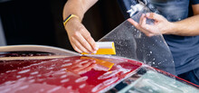 Master Man Installs Strip Of Vinyl Film In Risk Zone Of Windshield To Protect Car Body Paint From Scratches And Chips