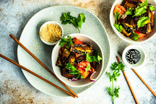 Two Bowls Of Asian Summer Salad With Eggplant, Tomato, Coriander, Sesame Seeds And Soy Sauce