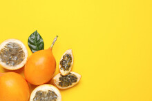 Delicious Ripe Granadillas With Leaf On Yellow Background, Flat Lay. Space For Text