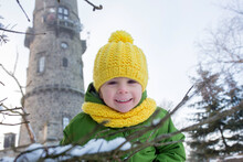 Cute Toddler Child, Sweet Boy, Posing In Front Of Beautiful Winter View Of Frosted Trees And Rock At Sunset, Frozen Lookout Tower Sneznik