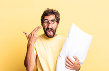 Expressive Crazy Man Looking Unhappy And Stressed, Suicide Gesture Making Gun Sign And Holding A Pillow