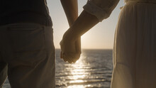 Strong Man Holding Beloved Woman By Hand Against Sunrise Over Sea, Happy Future