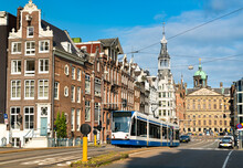 City Tram On A Street Of Amsterdam