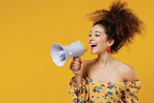 Young Happy Fun Smiling Beautiful Woman 20s With Culry Hair Wear Casual Clothes Hold Scream Aside In Megaphone Announces Discounts Sale Hurry Up Isolated On Plain Yellow Background Studio Portrait