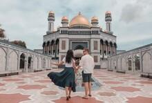 Man And Woman Walking Towards Jame' Asr Hassanil Bolkiah Mosque