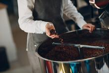 Man In Apron Roasting Coffee Beans