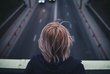 Person Standing On Bridge Facing Freeway