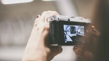 Person Taking Photo Of Train With A Digital Camera