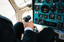 Pilot Holding Controller Flying An Airplane
