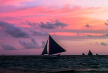 Silhouette Of Boats Sailing In Sea During Sunset