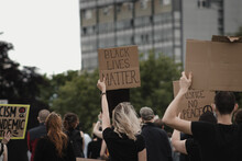 """Woman Holding Banner With Words """" Black Lives Matter""""  At Protest"""