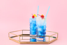 Glasses Of Blue Lagoon Cocktail On Color Background