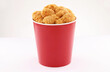 Leinwandbild Motiv breaded fried chicken legs bucket isolated on white background2