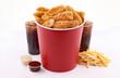 Leinwandbild Motiv breaded fried chicken bucket with drink and french fries