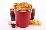 breaded fried chicken bucket with drink and french fries